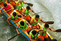 People rowing dragon boat in racing Stock Photos