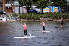 People rowing Stand Up Paddleboard Royalty Free Stock Photo