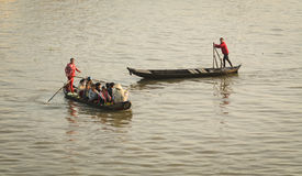 People rowing wooden boats on the Mekong river in Sadek, Vietnam Stock Photos