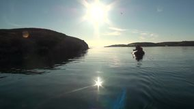 People in a rubber boat in Ocean on New Earth Vaigach. stock video