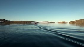 People in a rubber boat in Ocean on New Earth Vaigach. stock video footage