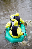 People in rubber boat Stock Photography