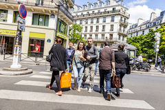People at Rue de Rivoli. PARIS, FRANCE - JUNE 9, 2015: people at Rue de Rivoli. It is one of the most famous streets of Paris, a commercial street whose shops royalty free stock photography