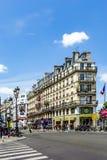 People at Rue de Rivoli. PARIS, FRANCE - JUNE 9, 2015: people at Rue de Rivoli. It is one of the most famous streets of Paris, a commercial street whose shops stock photos