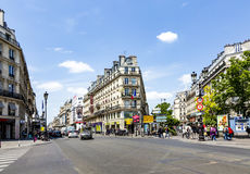 People at Rue de Rivoli. PARIS, FRANCE - JUNE 9, 2015: people at Rue de Rivoli. It is one of the most famous streets of Paris, a commercial street whose shops royalty free stock images