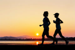 People run at beach Royalty Free Stock Images