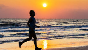 People run at beach Royalty Free Stock Photography