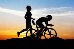 People run and cycling at mountain Royalty Free Stock Image