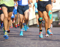 People run fast during sports race through the streets of the ci Stock Images
