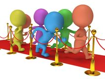 People run on red event carpet with golden rope barriers Royalty Free Stock Images