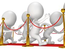 People run on red event carpet with golden rope barriers Stock Images