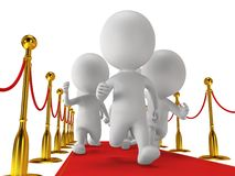 People run on red event carpet with golden rope barriers Stock Photography