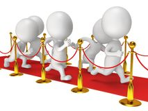 People run on red event carpet with golden rope barriers Stock Photos