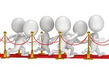 People run on red event carpet with golden rope barriers Royalty Free Stock Image