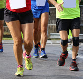People run during sports race through the streets of the city Royalty Free Stock Images