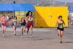 People run to catch the first row after buying their tickets at FIB Festival Stock Image