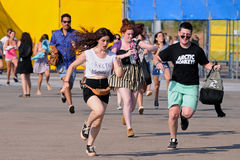 People run to catch the first row after buying their tickets at FIB Festival Stock Photography