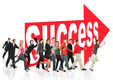 People Run To Success Following The Arrow Sign Stock Photography