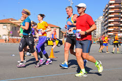 People run in the Zurich Barcelona Marathon through the streets of the city Royalty Free Stock Photo