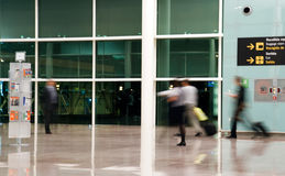 People running at airport Stock Photos