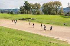People running on a ancient stadium. Royalty Free Stock Photo