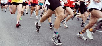 People running in city marathon Stock Photo