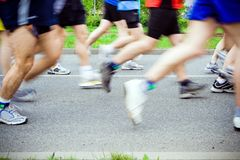 People running in city marathon, sport shoes Royalty Free Stock Images