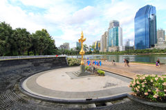 People running and cycling in Benjakiti public park, Bangkok,Thailand Royalty Free Stock Photo