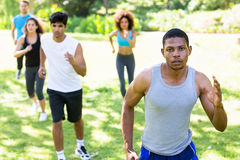 People running for fitness in the park Royalty Free Stock Photo