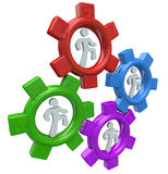 People Running in Gears to Power Teamwork and Progress Royalty Free Stock Photo
