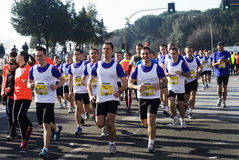 People running in a half marathon. Competitors running in the Rome half marathon on the 1st of March 2015, Italy stock images