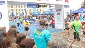 People running at half Marathon event stock video footage