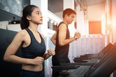 People running in machine treadmill at fitness gym royalty free stock photo