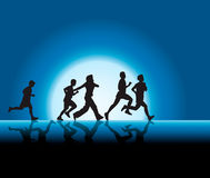 People running in moonlight Royalty Free Stock Photos