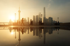 People running in morning at Huangpu River riverside with Shangh. Ai downtown in background in Shanghai, China Stock Photography