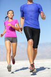 People running - runner fitness couple in desert. Couple runners training outside. Closeup of fit male runner legs. Man and women training together outdoors royalty free stock images