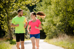 People running and talking together Stock Image