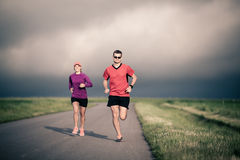 People running training on country road Royalty Free Stock Photography
