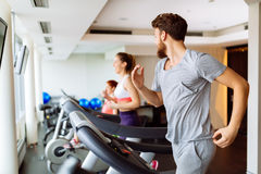 People running on treadmill in gym Stock Images