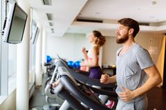 People running on treadmill in gym. Doing cardio workout Royalty Free Stock Images