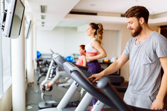 People running on treadmill in gym. Doing cardio workout Stock Photo