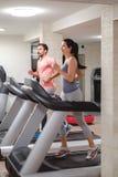 People running on treadmill stock image