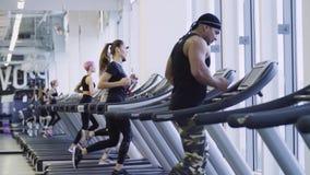 People running on the treadmill stock footage