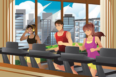 People running on treadmills Stock Photo