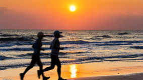People running on twilight time Royalty Free Stock Photos