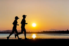 People running on twilight time Royalty Free Stock Photography