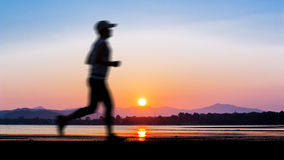 People running on twilight time Royalty Free Stock Photo