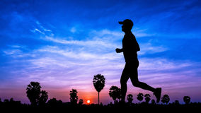 People running on twilight time Stock Image