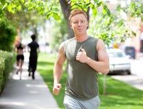 People running on walkway Royalty Free Stock Image