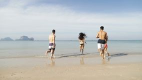 People Running In Water Back Rear View, Girl And Two Couple On Beach Tourists. Slow Motion 120 stock footage